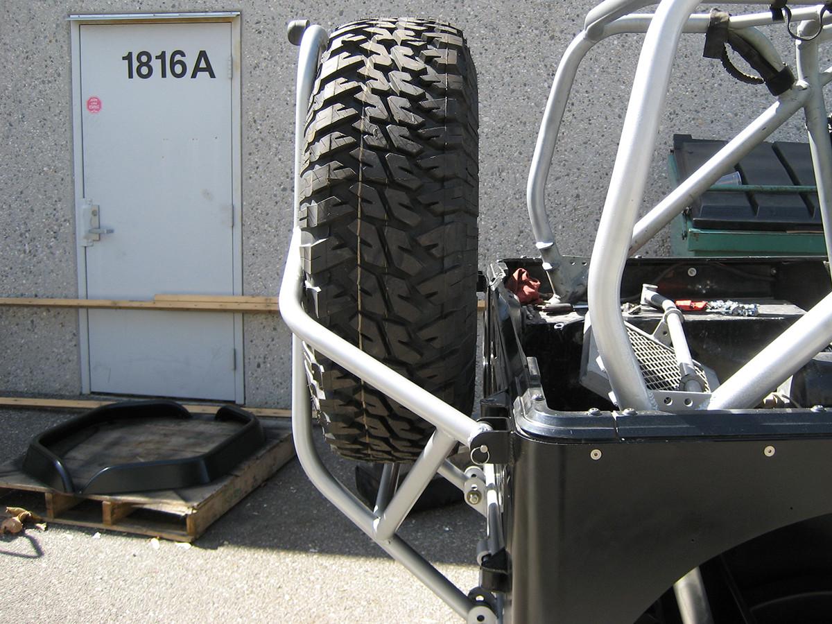 yj boulder series rear tire carrier aluminum genright. Black Bedroom Furniture Sets. Home Design Ideas