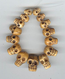 BONE: Oriental Skull Bead, Graduated Bone Skull Head Set, 15 pieces, 6 sizes, top drilled, from 8x10mm to 10x20mm, (1 set of beads)