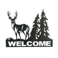 Welcome sign with buck and tree in the background