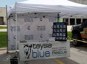Step and repeat banner for Taysia Blue, a non-profit focused on Husky Rescue, printed by StickersBanners