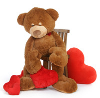 Chester Mittens is a soft cuddly light brown sleepy teddy bear holding a plush red heart – use him as a body pillow! Standing 4 1/2 FT (52in)