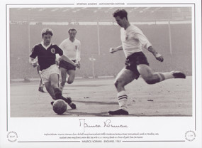 England defender Maurice Norman clears the ball away from Scotland's Willie Henderson during a Home International match at Wembley, 1963. Scotland came away from London that day with a 2-1 victory, thanks to a brace of goals from Jim Baxter. Great addition to any collection.