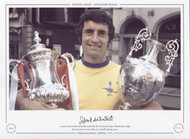 Arsenal captain Frank McLintock proudly holds the FA Cup and League Championship trophy, after the Gunners memorable 1970/71 double winning season.
