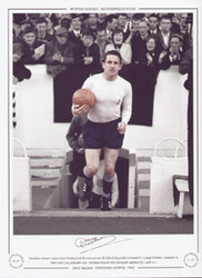 Tottenham Hotspur captain Dave Mackay leads his team out onto the field of play to face Liverpool in a League Division 1 encounter, at White Hart Lane in September 1965.