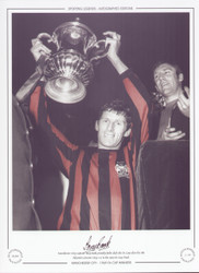 Manchester City captain Tony Book, proudly holds aloft the FA Cup after his side defeated Leicester City 1-0 in the 1969 FA Cup Final.
