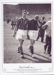 After helping Manchester City win the 1956 FA Cup (3-1), Bert Trautmann is helped off the pitch rubbing his injured neck. It later transpired that his neck was actually broken.