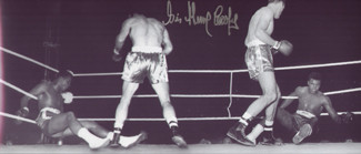 Superb signed mirror image photograph showing the moment in the fourth round when World Heavyweight Champion, Cassius Clay, was spectacularly floored by 'Enry's Ammer' - his trademark left hook at Wembley stadium 1963.