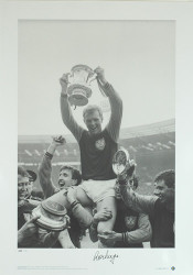 Bobby Moore celebrates with his team mates, after West Ham win the 1964 FA Cup Final at Wembley Stadium.