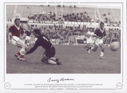 Terry Medwin scores the winning goal past Hungary keeper Grosics to put Wales 2-1 up in the 76th minute of this group C 2nd place play off game in the World Cup. Wales qualified for the quarter finals, only to be beaten 1-0 by the eventual winners Brazil.