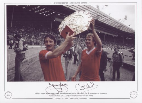 Jubilant Liverpool players Jimmy Case and Phil Neal show their fans the Charity Shield. A goal from Terry McDermott sealed the win against West Ham United at Wembley in 1980.