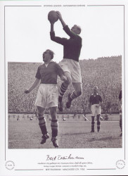 Manchester City goalkeeper Bert Trautmann claims a high ball against Chelsea during a League Division 1 game at Stamford Bridge in 1955.
