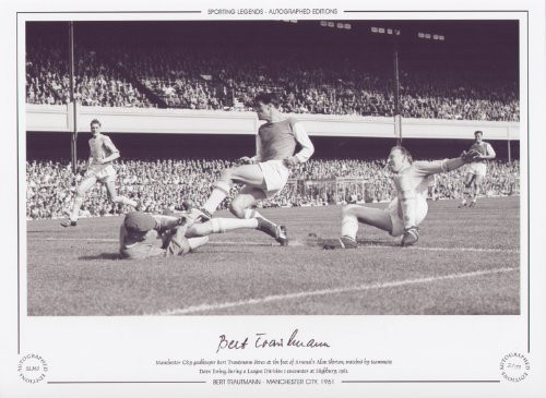 Manchester City goalkeeper Bert Trautmann dives at the feet of Arsenal's Alan Skirton, watched by teammate Dave Ewing, during a League Division 1 encounter at Highbury, 1961.