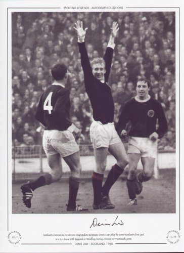 Scotland's Crerand & Henderson congratulate teammate Denis Law after he scored Scotland's first goal in a 2-2 draw with England, at Wembley in 1965.