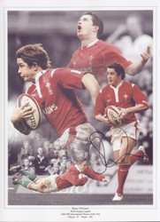 "Shane Williams was awarded his first cap by Graham Henry as a replacement against France in 1999–2000 Six Nations season, he went onto make 87 appearances scoring 290 points, in 2008 he was voted IRB international player of the year.  The montage is 16""x12"" (405mm x 305mm) and was signed by Shane Williams at a private signing session held on 11 July 2012."