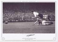 Legendary Bolton Wanderers centre-forward Nat Lofthouse perfects a diving header, July 1957.   Great action picture featuring one of the true greats of English football.