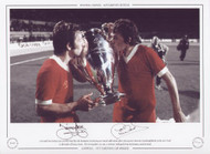 Liverpool duo Jimmy Case and Phil Neal kiss the European Cup during post match celebrations after victory over Borussia Monchengladbach, in the 1977 Final at the Stadio Olimpico, Rome. The Merseysiders ran out 3-1 winners with goals from McDermott, Smith & Neal.
