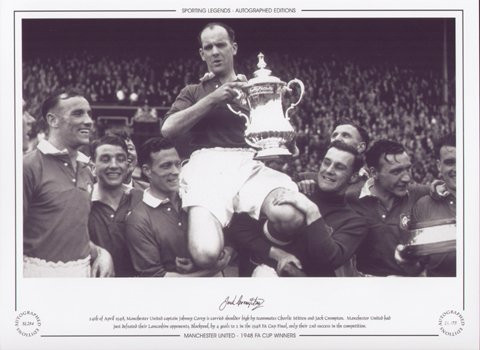24th April 1948, Manchester United captain Johnny Carey is carried shoulder high by teammates Charlie Mitten and Jack Crompton. Manchester United had just defeated their Lancashire opponents, Blackpool 4-2 in an epic Final.