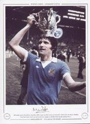 Mike Doyle, captain of Manchester City, shows off the League Cup after victory over Newcastle United in the 1976 final at Wembley. Goals from Dennis Tueart and Peter Barnes were enough to see off their rivals from the north-east by 2-1.