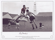 Manchester United defender Bill Foulkes jumps for a high ball with Peter Broadbent of Wolverhampton Wanderers during a League Division one game, October 1959.