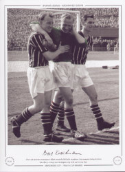 A hurt and dazed Bert Trautmann is helped around the field by Manchester City teammates Ewing & Leivers after their 3-1 victory over Birmingham City in the 1956 FA Cup Final.