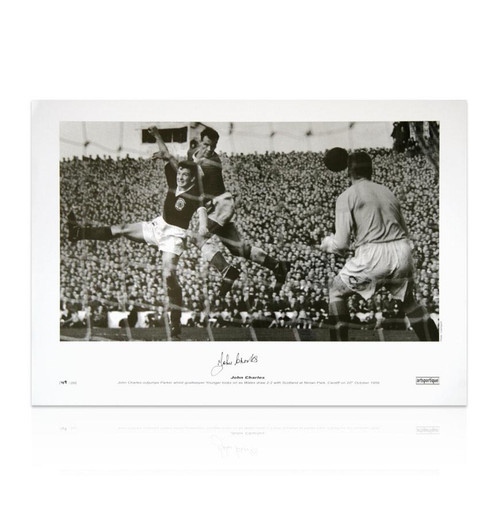 Wales legend John Charles out jumps Parker whilst goalkeeper Younger looks on as Wales draw 2-2 with Scotland at Ninian Park, Cardiff on 20th October 1956. This specially commissioned Limited Edition print was signed  by the late John Charles at a specially commissioned signing held at Aberystwyth FC when he opened their new stand.