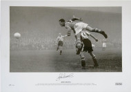 Leeds United Legend the late John Charles leaps over Brentford's Marsh to score for Leeds United at Griffin Park on 17 October 1953. Charles scored a club record 42 league goals in season 1953/54. Signed by the late John Charles at a specially commissioned signing held at Aberystwyth FC when he opened their new stand.