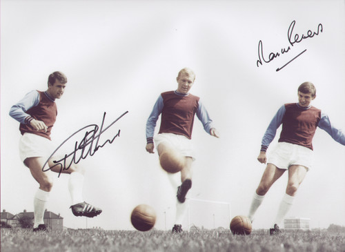 Photograph of West Ham Legends Geoff Hurst, Bobby Moore and Martin Peters training. Great picture signed by Geoff Hurst & Martin Peters.