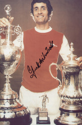 Arsenal Double Winners 1971. Frank McLintock poses with the League & FA Cup Trophies in 1971.