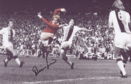 """Manchester United Legend Denis Law in action against Crystal Palace 1970's. This superb action photograph, is 16"""" x 12"""" (410mm x 305mm) and has been signed by Denis Law at a commercial signing session."""