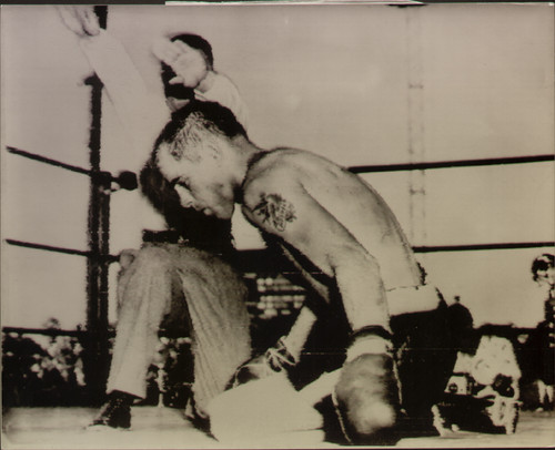 On offer is an original radio/wire photograph showing referee Mushy Callahan waving back Sugar Ray Robinson as Olson goes down for the count. Sugar Ray Robinson retained his title by defeating Carl Bodo Olson in round four, Los Angeles 18 May 1956.
