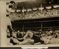 On offer is an original radio/wire photograph showing Sugar Ray Robinson standing over Carl Bodo Olson after knocking him out in the fourth round of their World Middleweight title fight in Los Angeles 18 May 1956.
