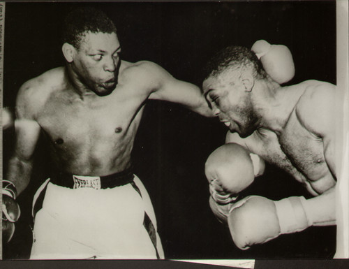 original radio/wire photograph of Cuban heavyweight boxing champion Nino Valdes in action against Johnny Holman of Chicago during their ten round bout at Portland, Oregon on 8 May 1957, Valdes won a unanimous points decision.