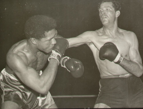 original radio/wire photograph of West German Willi Hoepner in action against Yolande Pompey of Trinidad during their ten round light-heavyweight bout Hamburg on 10 May 1957. Hoepner, former European Champion won a unanimous points decision.