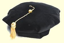 Black 8 corner tam.  Deluxe velvet has 2 button gold metallic attached tassel.