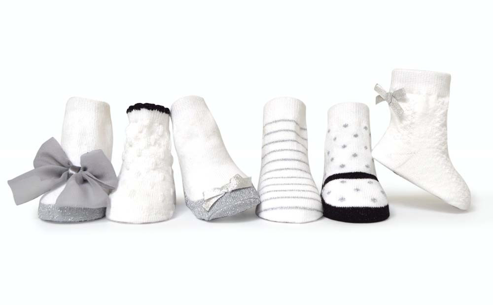 6 pairs of socks for baby girls in white, black and grey.   Babies love our socks that stay on.