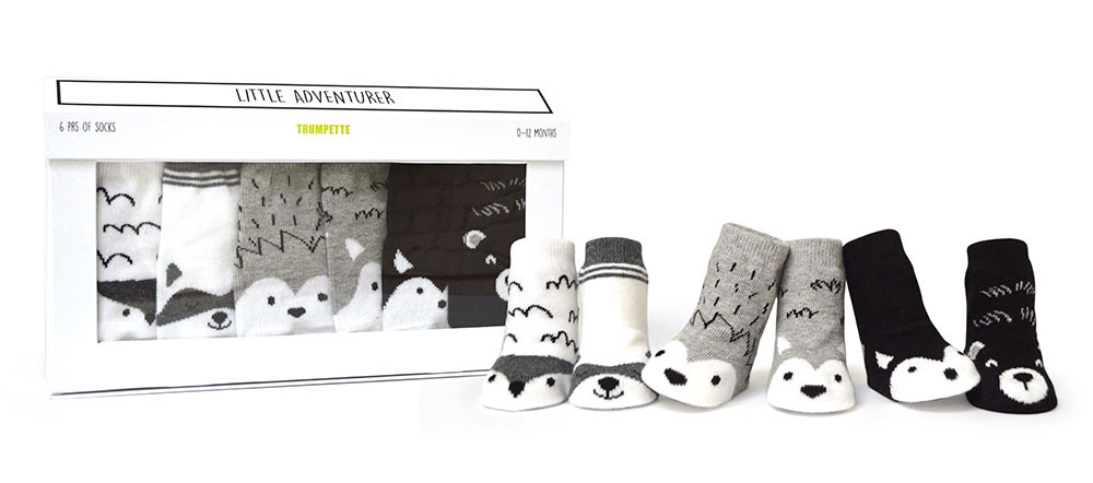 Six pairs of boy's baby socks that look like little animals.  Black, white and grey.