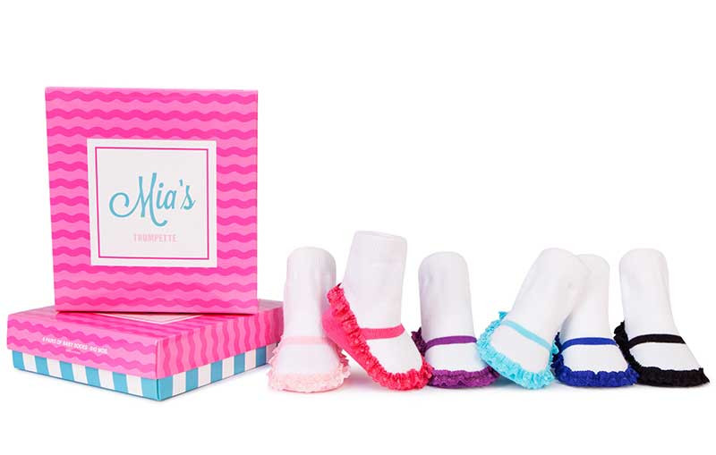 6 pair of white socks woven to look like maryjane shoes.  Pink, Blue and black. In a gift box.  For baby girls.