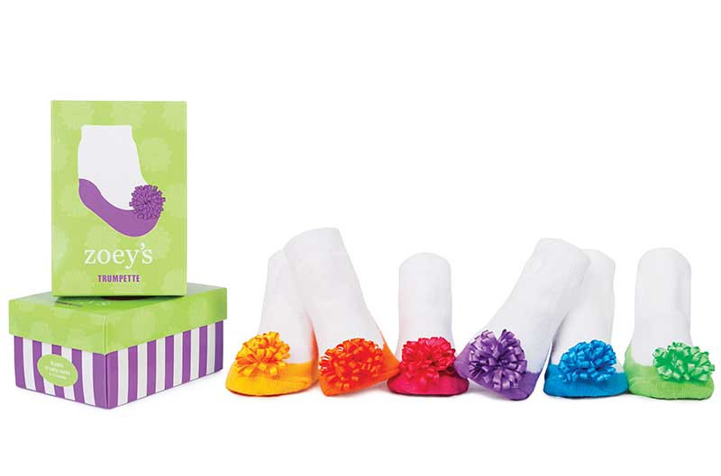 6 pairs of brightly colored cotton socks for baby girls in gift box.  Pom Poms on the toe.