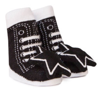 Cotton socks for babies with star rattle attachment.  Look like black and white athletic shoes