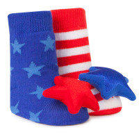 Red striped and blue star baby socks with rattle attachment in a gift box. Ages 0 - 12 months.