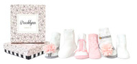 6 pairs of cotton socks for baby girls.  Ages 0 -12 months.  In a gift box.
