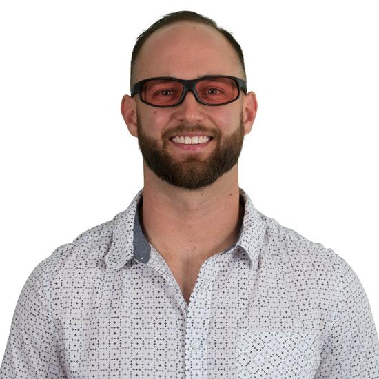 Man wearing Wrap TheraSpecs Indoor glasses
