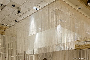 White String Curtain hanging From Celing