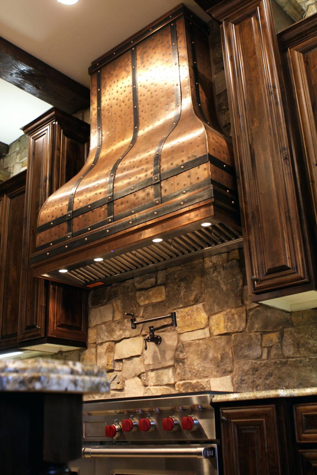large kitchen range hood, sink and dining table