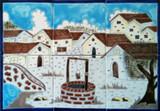 white village colorful tile mural