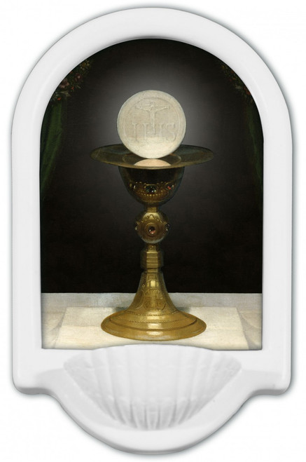 Catholic priest at consecration with chalice and host in ...