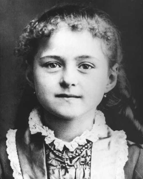 St. Therese print in assorted frames
