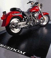 "BLT Standard Grade (.055"" thick)Motorcycle Mat is specially formulated to stand up to motorcycle kickstands. Includes ""Freedom"" logo design on one edge. Also available in Extra-Tough heavy duty grade: .085"" thick."