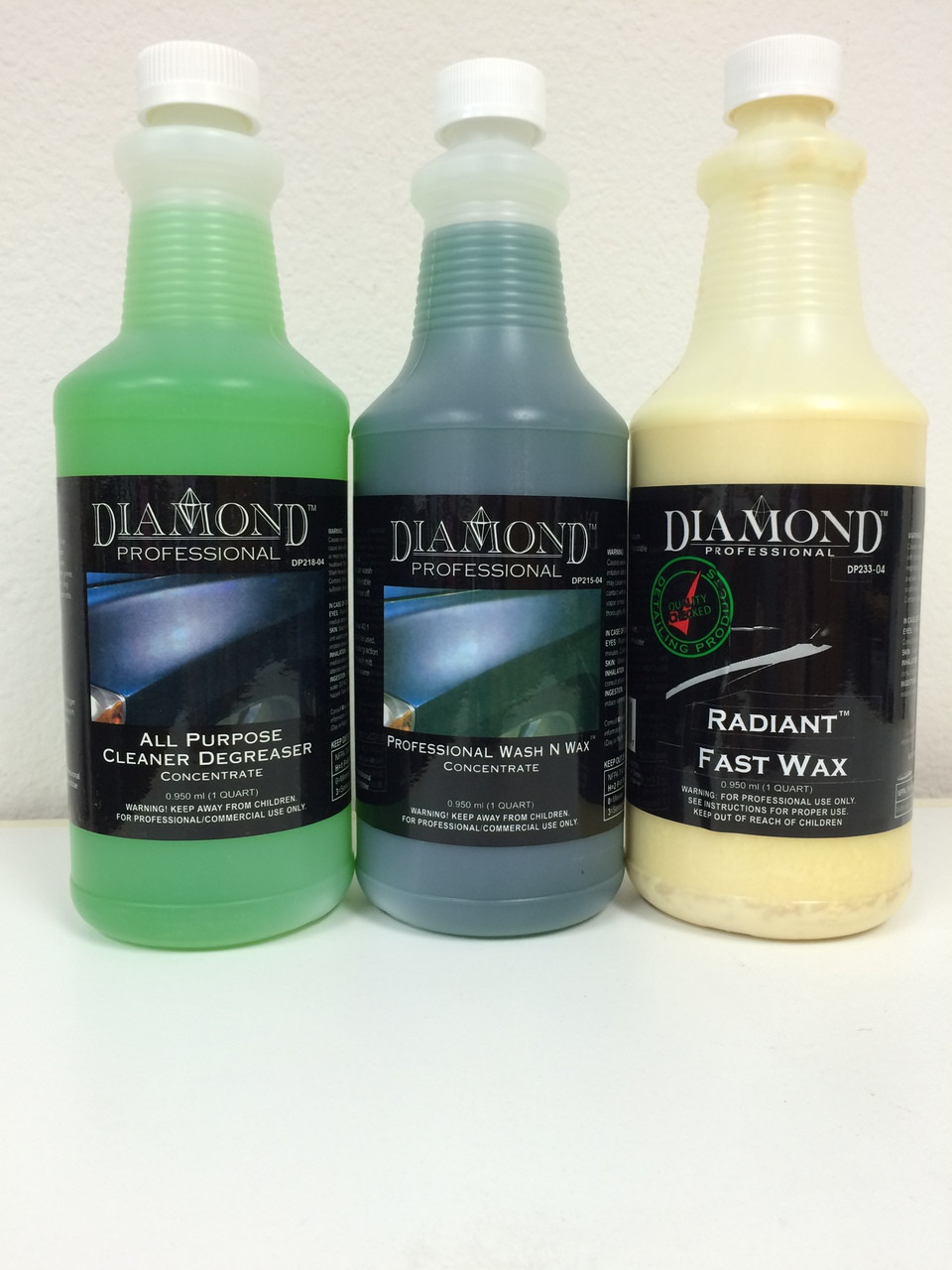"""Taking care of your car is made easy with these 3 easy steps--cleaning, washing and protecting.  We recommend this kit for those detail jobs that need a little extra """"elbow grease"""" on the exterior.  Let Diamond Professional products do the work for you!  You can prolong the beauty of your car at a discounted price with just 3 products.  We've included some of our most effective products in our 1-2-3 Degreaser Kit (quart sizes):  All Purpose Cleaner Degreaser removes road grime deposits and is also excellent as an engine, undercarriage and tire cleaner. (Please note dilution recommendations for consistent results.) Professional Wash 'N Wax rinses off road film and soap easily, leaving a lustrous shine while brightening chrome and glass beautifully. (Please note dilution recommendations for consistent results.) Radiant Fast Wax protects paint finish from environmental elements while still safe to use on vinyl moldings as well as stripes and decals."""