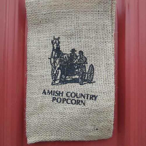 Burlap Bag Couple in Wagon | Amish Country Popcorn in Indiana